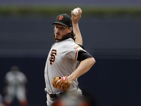 San Francisco Giants starting pitcher Jeff Samardzija works against a San Diego Padres batter during the first inning of a baseball game, Sunday, July 16, 2017, in San Diego. (AP Photo/Gregory Bull)