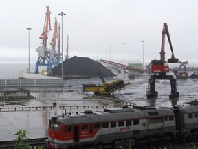 In this July 24, 2016, photo, coal from Siberia awaits loading on a ship bound for China in the North Korean special economic zone of Rason.