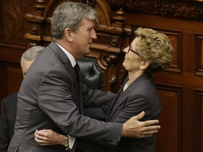 Glen Murray and Kathleen Wynne in 2014 after the swearing-in ceremony
