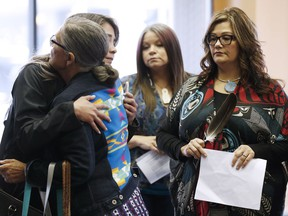 Family members of the Missing and Murdered Indigenous Women and Girls (MMIWG) and Coalition Co-chairs greet each other prior to a press conference calling for a re-organization of the National Inquiry into Missing and Murdered Indigenous Women and Girls (MMIWG) in Winnipeg, Wednesday, July 12, 2017.