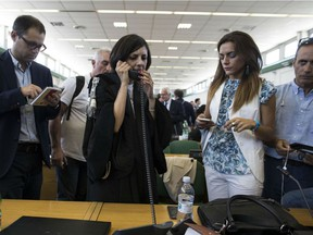 Massimo Carminati's lawyer, Ippolita Naso, talks at the phone in the bunker court of the Rebibbia prison after the reading of the sentence of verdict, delivered at the end of a corruption trial in Rome, Thursday,  July 20, 2017.
