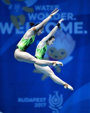 Jun Hoong Cheong and Pandelela Pamg of Malaysia compete in the women's diving 10m synchronized platform preliminary at the Swimming World Championships in Duna Arena in Budapest, Hungary, Sunday, July 16, 2017. (Tibor Illyes/MTI via AP)