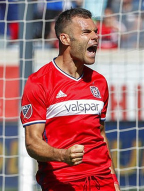 FILE - In this June 10, 2017, file photo, Chicago Fire forward Nemanja Nikolic celebrates after scoring on a penalty kick against Atlanta United goalkeeper Alec Kann during the second half of an MLS soccer match in Bridgeview, Ill. Just six months after his arrival, Nikolic has fit right in with the Fire and he is scoring lots of goals. (AP Photo/Kamil Krzaczynski, File)