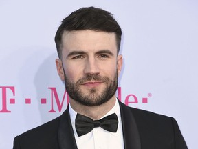 """FILE - In this May 21, 2017 file photo, Sam Hunt arrives at the Billboard Music Awards in Las Vegas. Hunt has beaten out Florida Georgia Line for a record number of weeks atop Billboard's Hot Country Songs chart with his single """"Body Like a Back Road."""" (Photo by Richard Shotwell/Invision/AP, File)"""