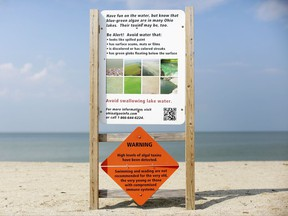 FILE – This Sept. 1, 2015, file photo shows a warning sign for algal toxins on a beach in Maumee Bay State Park, located on Lake Erie in Oregon, Ohio. Researchers are working on creating an early warning system that can spot when algae begins showing up on hundreds of lakes across the U.S., using real-time data from satellites that already monitor harmful algae hotspots on Lake Erie in Ohio and on the Chesapeake Bay along the East Coast. (AP Photo/Haraz N. Ghanbari, File)