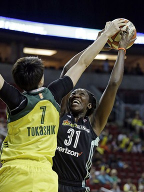 Seattle Storm's Ramu Tokashiki (7) tries to block a shot by New York Liberty's Tina Charles during the first half of a WNBA basketball game Thursday, July 6, 2017, in Seattle. (AP Photo/Elaine Thompson)