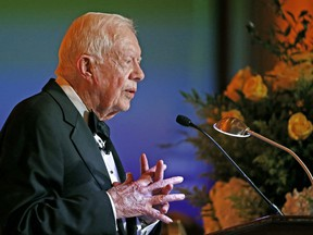 In this Jan. 27, 2017 file photo, former President Jimmy Carter speaks in Phoenix. Carter has been treated for dehydration while volunteering with Habitat for Humanity in Winnipeg.