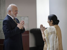 Indian Foreign Minister Sushma Swaraj, right, greets her Iraqi counterpart Ibrahim al-Jaafari in New Delhi, India, Monday, July 24, 2017. Al-Jaafari is on a five-day official visit to India. (AP Photo/Manish Swarup)