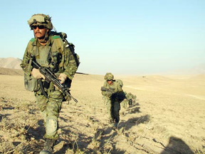 Canadian soldiers on patrol in Kandahar in 2002. The conflict still haunts Canada, John Ivison writes.