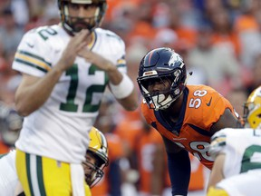 Denver Broncos outside linebacker Von Miller (58) watches as Green Bay Packers quarterback Aaron Rodgers (12) calls time out during the first half of an NFL preseason football game, Saturday, Aug. 26, 2017, in Denver. AP Photo/Joe Mahoney)