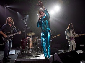 Tragically Hip frontman Gord Downie, centre, leads the band through a concert in Vancouver, Sunday, July 24, 2016. A new biography on the Tragically Hip and band frontman Gord Downie will be published in 2018. THE CANADIAN PRESS/Jonathan Hayward