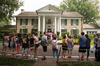 Fans line up outside Graceland, Elvis Presley's Memphis home, on Aug. 15, 2017, in Memphis, Tennessee.