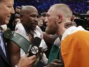 Floyd Mayweather embraces Conor McGregor in the ring after their super welterweight boxing match on Aug. 26.