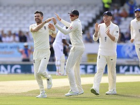 England's James Anderson celebrates after taking the wicket of West Indies Shai Hope during day three of the the second cricket Test Match England versus West Indies at Headingley, Leeds, England, Sunday Aug. 27, 2017. (Nigel French/PA via AP)