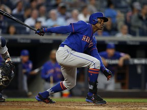 New York Mets' Curtis Granderson hits a home run against the New York Yankees during the third inning of a baseball game Monday, Aug. 14, 2017, at Yankee Stadium in New York. (AP Photo/Rich Schultz)