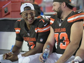 Cleveland Browns quarterback DeShone Kizer (7) shares a laugh with tackle Joe Thomas (73) during the third quarter of an NFL preseason football game against the Tampa Bay Buccaneers Saturday, Aug. 26, 2017, in Tampa, Fla. (AP Photo/Phelan Ebenhack)