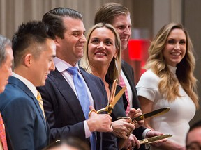Donald Trump Jr.,  executive vice president of Trump Organization Inc., his wife Vanessa Trump, Eric Trump,  executive vice president of Trump Organization Inc., and his wife Lara Yunaska Trump, participate in the ribbon cutting ceremony during the grand opening of Trump International Hotel & Tower in Vancouver, on Tuesday, Feb. 28, 2017. Trump International Hotel & Tower Vancouver is the first new hotel to bear the name of Trump since he took office.