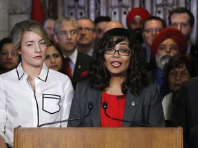 Liberal MP Iqra Khalid makes an announcement about an anti-Islamophobia motion on Parliament Hill while Minister of Canadian Heritage Melanie Joly looks on in Ottawa on Wednesday, February 15, 2017. The MP who touched off a fiery debate across Canada with a motion on Islamophobia, is urging parliamentarians to take a unified approach to find ways to combat it.