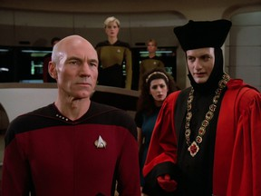 Patrick Stewart as Captain Jean-Luc Picard, (R) John de Lancie as Q, (Back right) Marina Sirtis as Counselor Deanna Troi and (back center) Denise Crosby as Lieutenant Tasha Yar in the first episode of Star Trek: The Next Generation called Encounter at Farpoint from 1987.