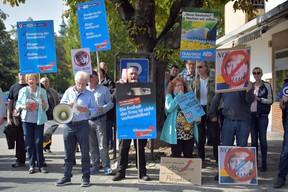 Supporters of the right-wing Alternative for Germany (AfD) political party demonstrate against the German Chancellor and Christian Democrat (CDU) Angela Merkel at a CDU election campaign stop on September 22, 2017 in Heppenheim, Germany.