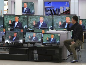 TV screens show a news program with an image of U.S. President Donald Trump in his address at the U.N. General Assembly, at the Yongsan Electronic Market in Seoul, South Korea, Wednesday, Sept. 20, 2017