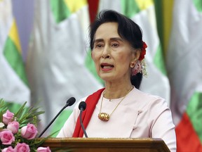 Myanmar's State Counsellor Aung San Suu Kyi delivers an opening speech during the Forum on Myanmar Democratic Transition in Naypyitaw, Myanmar.