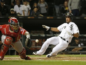 Chicago White Sox's Jose Abreu, right, scores past Los Angeles Angels catcher Martin Maldonado off a double by Nicky Delmonico during the fourth inning of a baseball game Wednesday, Sept. 27, 2017, in Chicago. (AP Photo/Charles Rex Arbogast)