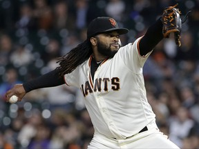 San Francisco Giants pitcher Johnny Cueto throws against the Colorado Rockies during the first inning of a baseball game in San Francisco, Tuesday, Sept. 19, 2017. (AP Photo/Jeff Chiu)