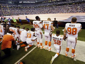 "FILE - In this Sunday, Sept. 24, 2017, file photo, members of the Cleveland Browns take a knee during the national anthem before an NFL football game against the Indianapolis Colts in Indianapolis. The NFL says the message players and teams are trying to express is being lost in a political firestorm. NFL spokesman Joe Lockhart said Thursday, Sept. 28, 2017, that it is important for ""everyone to understand what they are talking about, to not see everything in terms of who is up or down politically.""  (AP Photo/Michael Conroy, File)"