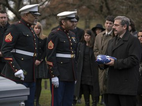 "This image released by Lionsgate shows Laurence Fishburne, from left, Bryan Cranston and Steve Carell in a scene from Last Flag Flying."" (Wilson Webb/Lionsgate via AP)"