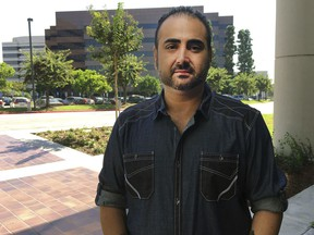U.S. Navy veteran Mohammed Jahanfar poses for a photo during an interview on Wednesday, Sept. 27, 2017, in Long Beach, Calif. Jahanfar, is seeking a visa to bring his Iranian fiancée to live with him in California, and fears that may not be possible due to the Trump administration's latest travel restrictions for Iran. (AP Photo/Amy Taxin)
