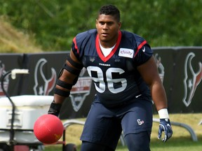 Eli Ankou performs a drill at Houston Texans training camp in White Sulphur Springs, W. Va., on July 26.
