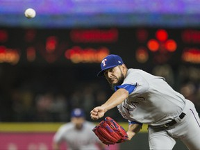 Texas Rangers starting pitcher Martin Perez (33) delivers against the Seattle Mariners in the third inning of a baseball game, Tuesday, Sept. 19, 2017, in Seattle. (AP Photo/Lindsey Wasson)