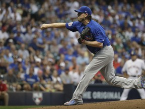 Chicago Cubs starting pitcher John Lackey throws during the first inning of a baseball game against the Milwaukee Brewers Friday, Sept. 22, 2017, in Milwaukee. (AP Photo/Morry Gash)