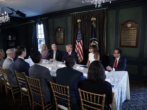 FILE - In this Aug. 8, 2017, file photo, President Donald Trump speaks during a briefing on the opioid crisis, at Trump National Golf Club in Bedminster, N.J. From left are, White House senior adviser Kellyanne Conway, Health and Human Services Secretary Tom Price, Trump, first lady Melania Trump, and National Drug Control Policy acting Director Richard Baum. Melania Trump has invited experts and people affected by addiction to opioids to the White House for a listening session and discussion about the epidemic. The first lady is hosting the Sept. 28 event in the State Dining Room and has invited journalists to attend a portion of the meeting to help raise awareness. (AP Photo/Evan Vucci, File)