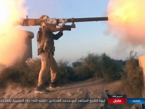 FILE - This photo posted online Thursday, Sept. 28, 2017, by supporters of the Islamic State group on an anonymous photo sharing website, purports to show an IS fighter firing a weapon during clashes with Syrian government troops in the eastern Syrian province of Deir el-Zour. While the U.S.-led coalition and Russian-backed Syrian troops have been focused on driving Islamic State from the country's east, an al-Qaida-linked insurgent coalition known as the Levant Liberation Committee has consolidated its control over Idlib, and may be looking to return to Osama bin Laden's strategy of attacking the West. (Militant Photo via AP, File)