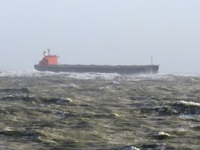 The photo provided by Germany's Central command for maritime emergencies shows the Panama-flagged bulk carrier Glory Amsterdam which ran aground off the shore of the German island of Langeoog on Sunday, Oct. 29, 2017. Germany was hit by a heavy storm on Sunday. (Central command for maritime emergencies via AP)
