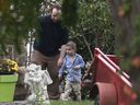 Joshua Boyle and his son Jonah play in the garden at his parents house in Smiths Falls, Ont., on Saturday, Oct. 14, 2017.