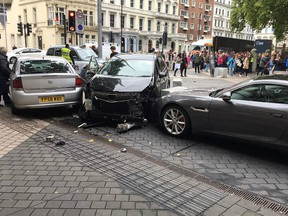 A handout picture obtained from the twitter user @StefanoSutter shows damaged vehicles on Exhibition Road, in between the Victoria and Albert (V&A) museum, and the Natural History Museum, in London on October 7, 2017