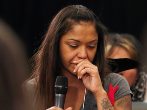 Isabel Daniels weeps as she speaks of her murdered cousin Nicole Daniels at the National Inquiry into Missing and Murdered Indigenous Women and Girls in Winnipeg, Monday, Oct. 16, 2017.