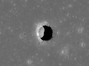 This is a spectacular high-Sun view of the Mare Tranquillitatis pit crater revealing boulders on an otherwise smooth floor. This image from LRO's NAC is 400 metres wide, north is up.