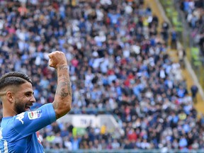 Napoli's Lorenzo Insigne celebrates after scoring during the Serie A soccer match between Napoli and Sassuolo, at the San Paolo stadium in Naples, Italy, Sunday, Oct. 29, 2017. (Ciro Fusco/ANSA via AP)