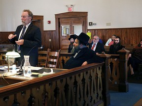 During a hearing at Orange Superior Court in Chelsea, Vt., on Wednesday, Oct. 18, 2017, defense attorney Robert Appel, left, argues there is no probable cause to charge his client Rabbi Berl Fink with a charge of attempting to elude police during an Aug. 7 traffic stop on Interstate 91 in Fairlee, Vt. Appel's motion was denied and Fink entered a not guilty plea. He is accused of failing to stop for suspected speeding for more than 4 miles on Interstate 91 in Thetford on the night of Aug. 8.  (Geoff Hansen/The Valley News via AP)