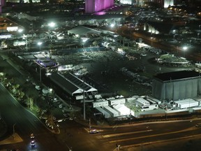 A night time view of the scene of a mass shooting, bottom right, on the Las Vegas Strip, Monday, Oct. 2, 2017, in Las Vegas. (AP Photo/Marcio Jose Sanchez)