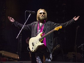 """FILE - In this Sept. 17, 2017 file photo, Tom Petty of Tom Petty and the Heartbreakers appears at KAABOO 2017 in San Diego, Calif. A spokesman for the Los Angeles Police Department says it has no information on the well-being of Tom Petty and its spokespeople did not provide info CBS News used to report the rocker had died. News outlets reported Monday, Oct. 2, that Petty was dead at age 66. CBS did not cite a source in its story, but tweeted that LAPD confirmed Petty's death. CBS now says he is """"clinging to life."""" (Photo by Amy Harris/Invision/AP, File)"""