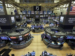 """Traders work on the floor of the New York Stock Exchange, Wednesday, Oct. 18, 2017. What if the stock market plunged 20 percent tomorrow? The question may seem absurd when the market is in the midst of one of its calmest runs in history and at record highs. But it's what investors had to deal with 30 years ago, when """"Black Monday"""" blasted stocks on Oct. 19, 1987. (AP Photo/Richard Drew)"""