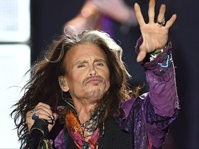 """FILE - In this May 26, 2017, file photo, singer Steven Tyler performs during an Aerosmith concert at the Koenigsplatz in Munich, Germany. In a statement posted to the band's website on Oct. 2, 2017, Tyler disputed rumors about his health surrounding an early end to the band's tour, saying he """"certainly did not have a heart attack or seizure."""" (AP Photo/Lukas Barth, File)"""