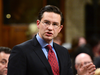 """Conservative finance critic Pierre Poilievre accused Bill Morneau of keeping """"secret from the Canadian people over $40 million of investments that he had in a company that he regulated."""""""