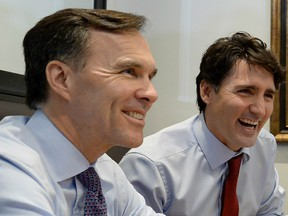Finance Minister Bill Morneau and Prime Minister Justin Trudeau at Pastaggio Italian Eatery, in Whitchurch-Stouffville, Ont., on Monday, October 16, 2017.