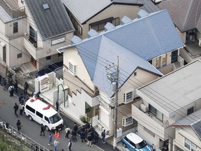 This aerial photo shows the apartment, centre, where police found dismembered bodies in coolers in Zama city, southwest of Tokyo on Tuesday, Oct. 31, 2017.